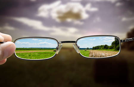 concept looking through glasses turns a gloomy day into a sunny one Stock Photo