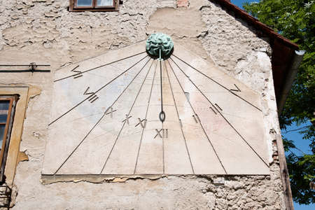 Zagreb, Croatia - Circa 2016: Old sundial or sun clock on the side of a house in the Tkalciceva street in Zagreb, Croatia Editorial