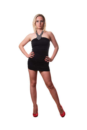 woman in a short black dress and red heels posing isolated on white background