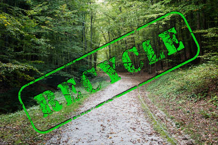 green recycle text stamp on a green forest landscape Stock Photo