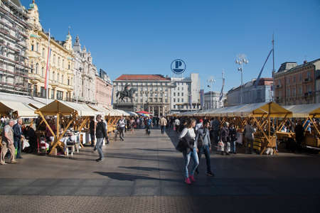Zagreb, Croatia – October 15th 2017: Ban Josip Jelacic Square during Necktie Days in Zagreb, Croatia. It is a central square in Zagreb, Croatia and it is often the center of numerous events in Croatia. Statue of Ban Josip Jelacic is decorated with neckt