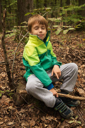 kid resting in the nature after a hike in autumn Stock Photo