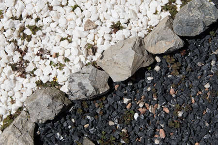 Black and White Decorative Garden Stones Divided Contrasting each other