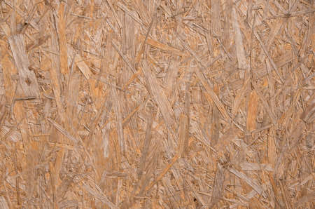 close-up of a brown pressed wood texture background