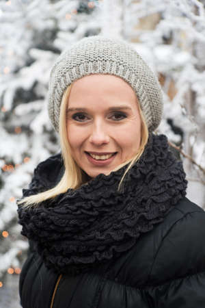 outdoor winter portrait of a young blonde woman out in the snow