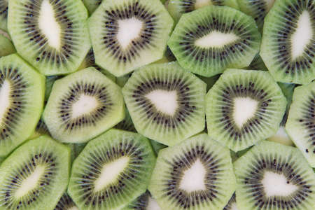 green slices of kiwi fruit texture background