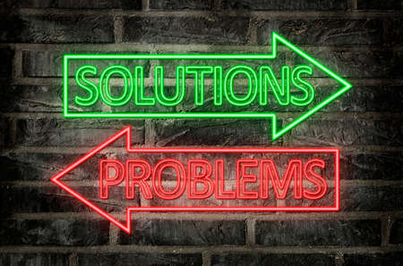 illustration of neon signs on a brick wall of an arrows with problems and solutions text