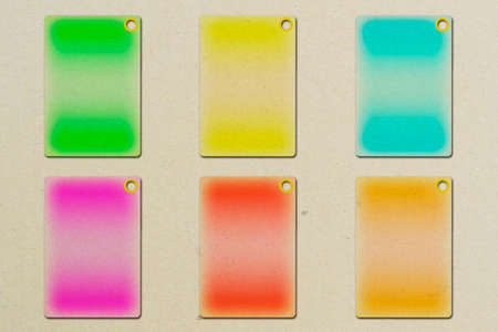 3D illustration of a blank cardboard tags in different colors Imagens