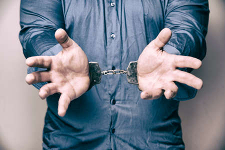 imprisoned man with handcuffs on his hands Stock Photo