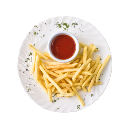 French fries and tomato sauce on the plate, isolated on white background. Top view