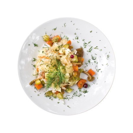 Plate with potato salad on a table. Top view