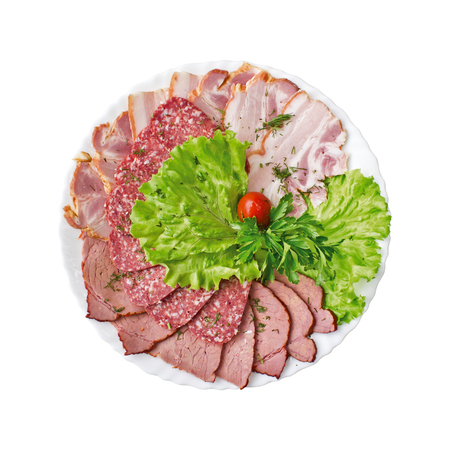 Sliced salami, bacon and ham with vegetables on a plate isolated. Top view Reklamní fotografie