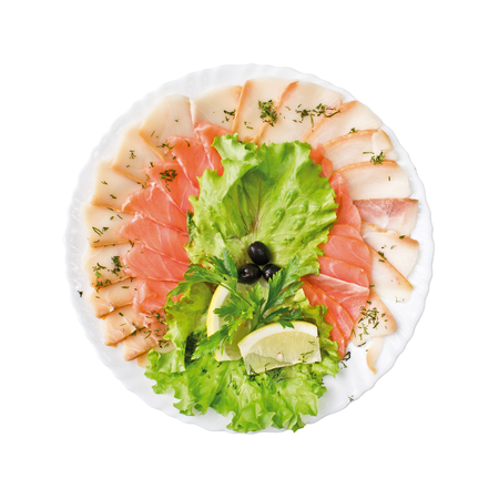 Pieces of fish and lettuce on a plate, isolated on white background. Top view.