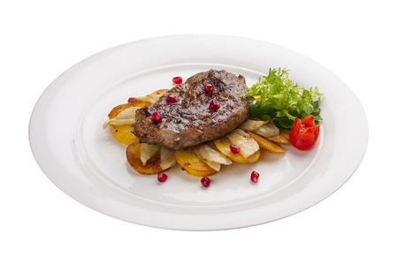 Beef steak with potatoes on a white plate