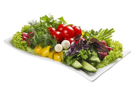 Set of fresh vegetables on a white plate Stock Photo