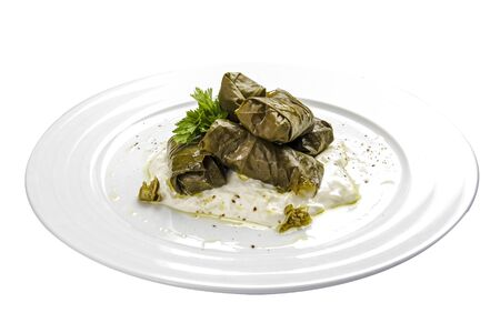 Dolma - stuffed grape leaves with rice and meat. Traditional Caucasian, Ottoman, Turkish and Greek cuisine