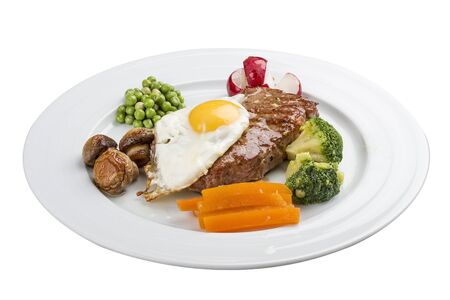 An average breakfast. Steak, egg and vegetables. On a white background
