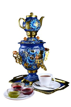Metal Russian samovar, with traditional ornaments and paintings. On a white background Imagens