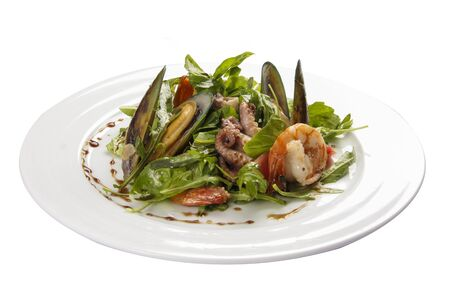 Seafood salad. A traditional Spanish dish. On a white background