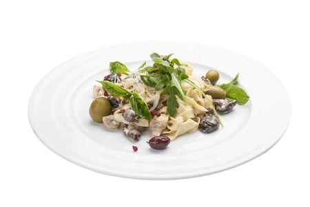 Tagliatelle with mushrooms and capers. On a white background