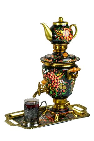 Metal Russian samovar, with traditional ornaments and paintings. On a white background 免版税图像