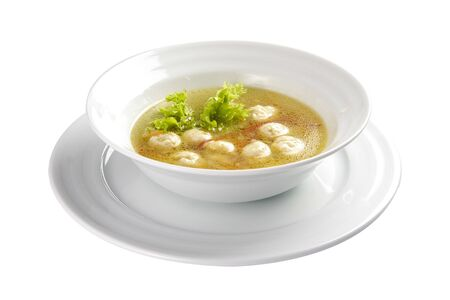 Soup Shetbulo. Light soup with meat and vegetable fricadals. A traditional Swiss dish. On a white background