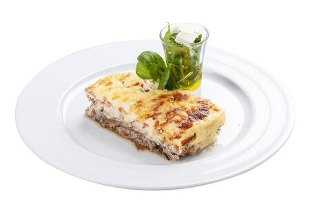 Moussaka. A traditional Greek dish. On a white background Stock Photo