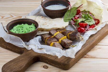Veal shashlik with green hummus and Dzadziki sauce with horseradish