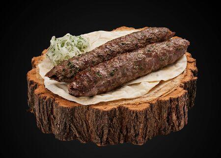 Lamb Kebab on a wooden slice 스톡 콘텐츠