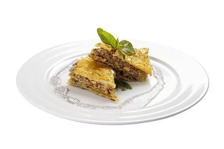 Baklava with walnuts and honey on white background. Jewish, turkish, arabic traditional national dessert