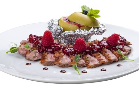 Duck breast with sauce of raspberry. On a white background
