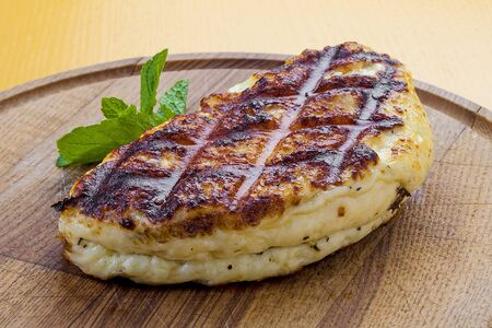 Fried Suluguni cheese on wooden Board Banco de Imagens
