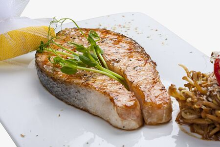 Salmon steak with roasted sprouts