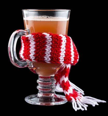 Sbiten. Warming drink with berries. In the glass with the scarf. Russian traditional cuisine. On dark background.
