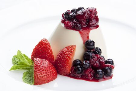 Dessert panna cotta with fresh berries on white background 스톡 콘텐츠