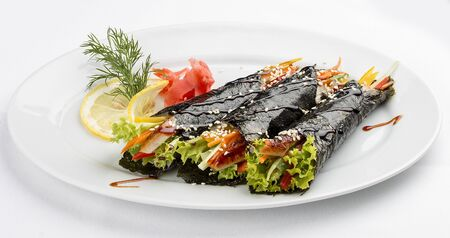 Temaki with eel and vegetables on a white background. Rolls in nori with a filling