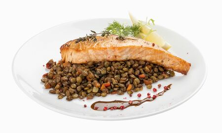 Salmon steak with lentils. On a white background