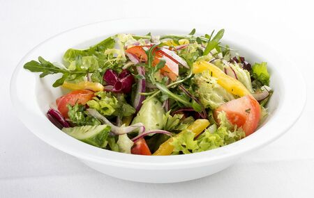 Fresh vegetable salad. On a white background 스톡 콘텐츠 - 131591098
