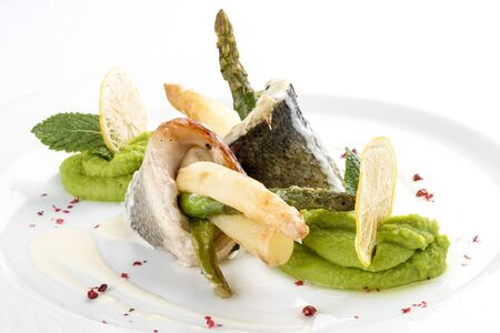 Fish fillet with asparagus. On a white background 스톡 콘텐츠