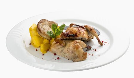 Quail with berry sauce. On white background 스톡 콘텐츠