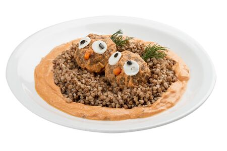 Childrens menu. Meatballs with buckwheat porridge and gravy. Decorated with figures of birds. On white background