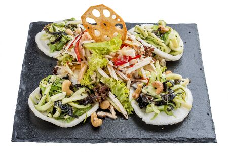 Asian salad with squid and Chinese mushrooms Tsey On a white background 스톡 콘텐츠 - 131590480