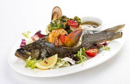 Carp with salad and seafood. On a white background