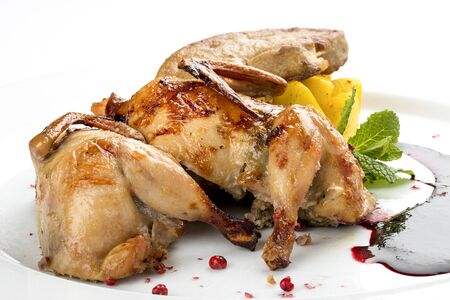 Quail with berry sauce. On white background 스톡 콘텐츠 - 131590457
