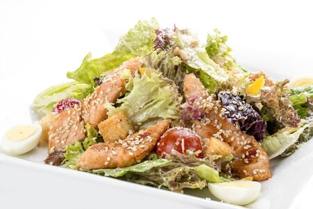 Caesar salad with chicken. On white background 스톡 콘텐츠