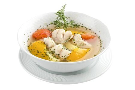 Fish soup with bell peppers and tomatoes. On a white background 스톡 콘텐츠