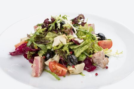 Salad with fried tuna and artichokes. On white background 스톡 콘텐츠 - 131590689