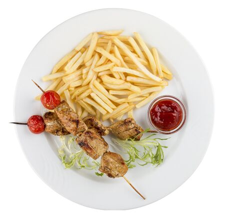 French fries with chicken skewer with red sauce. On white background