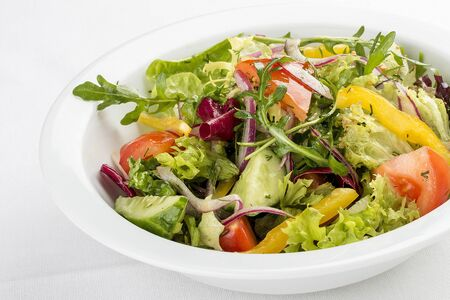 Fresh vegetable salad. On a white background 스톡 콘텐츠 - 131604887