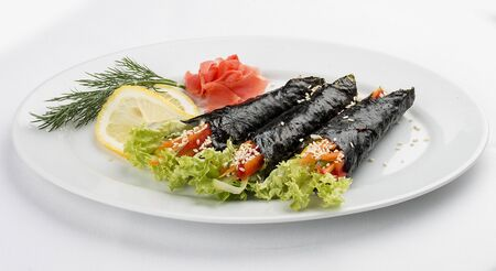 Temaki with vegetables on white background. Rolls in nori with a filling